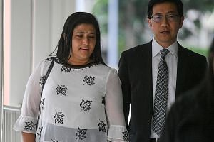 Gallop Stable's director Mani Shanker and defence counsel Simon Tan. Mr Tan told the court that Gallop spent close to $16,000 on the treatment and care of the horse, which is now healthy and still owned by the stable.