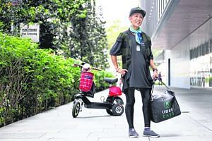 UberEATs food delivery dispatch Kathleen Teo Yoke Lan making food deliveries in the CBD district.
