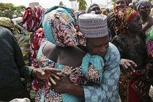 A father being reunited with one of the released Chibok girls in Abuja on May 20, 2017.