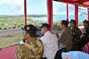 President Joko Widodo (third from left) and the top brass from the Indonesian military witnessing the show of force last Friday by the army, navy and air force in Tanjung Datuk on Bunguran Island, the main island of the resource-rich Natuna Islands.