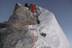 Members of the successful Natas Singapore Women's Everest Team making their way down the infamous Hillary Step in 2009.