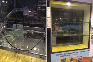A neat circle was cut out of the Mobile 8 shop's window this time, and six phones worth about $5,000 stolen.