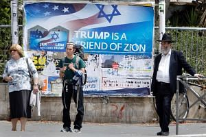 A welcome poster for US President Donald Trump put up in downtown Jerusalem, on May 21, 2017, on the eve of a two-day visit by the US president.