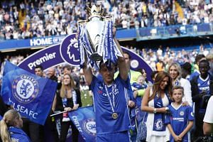 Chelsea's John Terry celebrates with the trophy on May 21, 2017 after winning the Premier League.