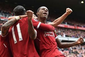 Liverpool's Georginio Wijnaldum celebrates scoring his team's first goal againts Middlesbrough on May 21, 2017.