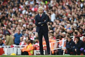Arsenal manager Arsene Wenger watches from the touchline during the match against Everton on May 21, 2017
