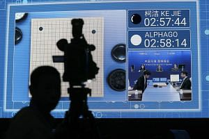 Chinese Go player Ke Jie against Google's artificial intelligence program AlphaGo during the Future of Go summit at Wuzhen internet international conference and exhibition center in Wuzhen, China's Zhejiang province, on May 23, 2017.