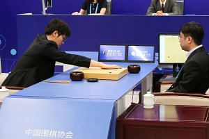 Chinese Go player Ke Jie puts a stone against Google's artificial intelligence program AlphaGo during their first match at the Future of Go Summit in Wuzhen, Zhejiang province, China on May 23, 2017.