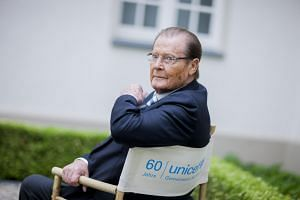 British actor Sir Roger Moore poses before an interview in Aachen, Germany, on June 25, 2013.