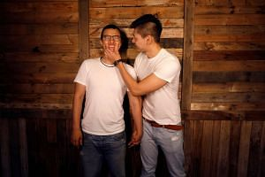 Gay couple Huang Chen-ting (left), a school administrator and Lin Chi-xuan, a personal trainer, pose for a photograph in Taipei.