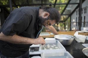 Chef Gaggan Anand prepares 'yogurt explosion' in the research and development kitchen at Gaggan restaurant in Bangkok, Thailand, on May 5, 2017.