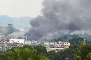 Philippine security forces bombing residential areas in Marawi as they battle entrenched Islamist militants who are holding hostages and have reportedly killed at least 11 civilians.