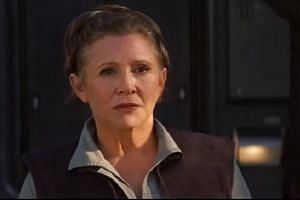 Carrie Fisher as General Leia Organa.