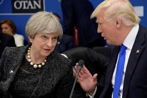 Trump (right) and British PM Theresa May at the Nato summit in Brussels, May 25, 2017.