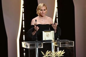 German actress Diane Kruger speaks after receiving the Best Actress Prize for the film In the Fade on May 28, 2017 during the closing ceremony of the 70th edition of the Cannes Film Festival in Cannes, southern France.