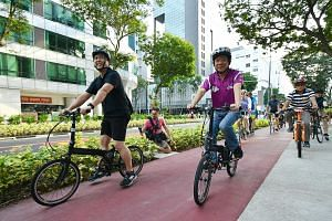 Coordinating Minister for Infrastructure and Minister for Transport Khaw Boon Wan using a dedicated cycling path at the launch of the revitalised Bencoolen Street yesterday.