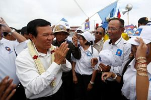 Mr Kem Sokha, leader of the opposition Cambodia National Rescue Party, greeting supporters during a campaign rally in Prey Veng province yesterday.