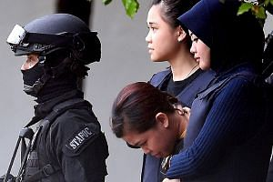 Indonesian national Siti Aisyah (face down) is escorted by Malaysian police after a court appearance at the magistrates' court in Sepang on April 13, 2017.