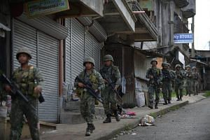 Philippine marines on their way to raid Muslim militants' hideout near the city hall in Marawi on the southern island of Mindanao on Sunday (May 28).