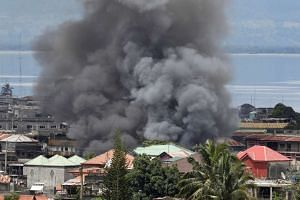Smoke billows in a residential neighbourhood in Marawi City on May 27, 2017.
