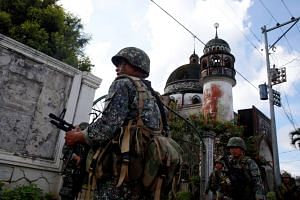 Philippine Marines stand guard outside a mosque in Marawi City in southern Philippines on May 30, 2017.