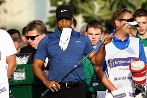 Tiger Woods pulled out of the Dubai Desert Classic due to back spasms prior to the second round. His surgery last month has a typical six-month recovery period.