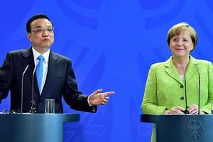 Chancellor Angela Merkel and   Prime Minister Li Keqiang give a joint press conference after representatives of both countries signed economic agreements at the end of Mr Li's two-day visit to Germany on June 1, 2017 in Berlin.