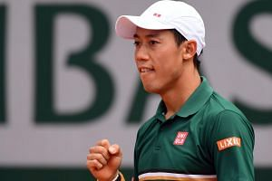 Japan's Kei Nishikori reacting after winning against South Korean Chung Hyeon during the French Open tennis tournament in Paris on June 4.
