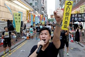 A protester in Hong Kong shouting before the start of a candlelight vigil to mark the 28th anniversary of China's bloody Tiananmen Square crackdown on June 4.