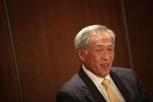 Minister for Defence Ng Eng Hen speaking to members of the media at the end of the IISS Shangri-La Dialogue, on June 4, 2017.