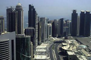 skyscrapers in the Qatari capital Doha on Oct 4, 2012.