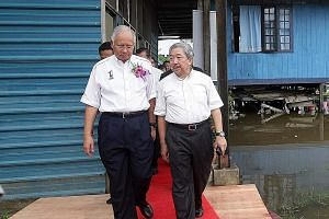 Mr Najib Razak and Mr Bustari Yusof at a school visit in 2008. Mr Bustari is said to act as the Malaysian Prime Minister's senior political counsel, chief troubleshooter and economic adviser. He is also said to be one of Mr Najib's closest friends an