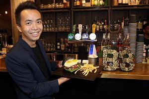 "SMU Alumni Association general manager Edwin Lim is also the manager of B3, which stands for ""burger, beer, bistro"", and oversees its operations."