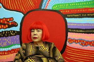 Japanese artist Yayoi Kusama in front of her latest artwork Life Is The Heart Of A Rainbow, which will be on display at her first major museum showcase in South-east Asia on June 9, 2017.