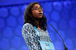 Ananya Vinay of Fresno, California concentrates as she spells a word during the 2017 Scripps National Spelling Bee at National Harbor in Oxon Hill, Maryland, U.S., June 1, 2017.