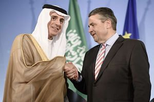 Saudi Foreign Minister Adel al-Jubeir (left) and German Foreign Minister Sigmar Gabriel pose for the media.