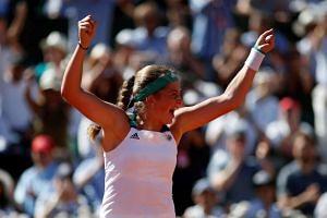 Jelena Ostapenko celebrates winning the French Open final.