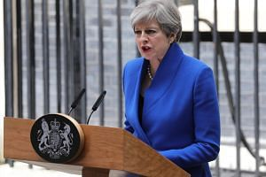Britain's Prime Minister Theresa May delivers a statement to the media outside No. 10 Downing Street after meeting the Queen in Buckingham Palace in London, Britain on June 9, 2017.