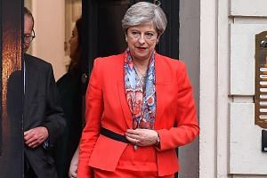 Mrs Theresa May leaving the Conservative Party HQ in London yesterday, hours after the polls closed in the British general election.