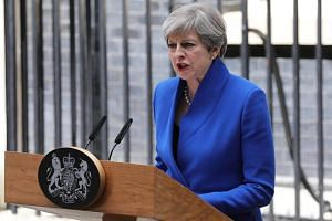 Britain's PM Theresa May delivers a statement to the media outside No. 10 Downing Street, on June 9, 2017.