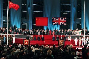 Then Chinese leader Deng Xiaoping hosting a meeting with then British Prime Minister Margaret Thatcher in Beijing on Sept 24, 1982. Mr Chris Patten, the 28th and last governor of colonial Hong Kong, receiving the Union Jack after it was lowered for t