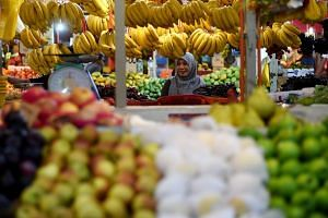 A woman shopping for fruits at a wholesale market in Kuala Lumpur, on May 19, 2017.