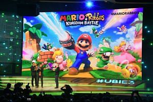 Ubisoft CEO Yves Guillemot (right) and game designer and producer Shigeru Miyamoto (centre), introduce Mario + Rabbits, Kingdom Battle to the E3 audience.