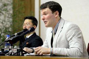 US student Otto Frederick Warmbier (right), who was arrested for committing hostile acts against North Korea, speaking at a press conference in Pyongyang on March 1, 2016.