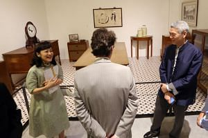 Mr Lee Hsien Yang and his wife Lee Suet Fern explain the uses and significance of furniture and exhibits in Mr Lee Kuan Yew's Oxley Road house at an exhibition at the National Museum on Sept 22, 2015.