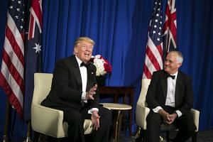 President Donald Trump (left) meets with Prime Minister Malcolm Turnbull of Australia (right), onboard the Intrepid Sea, Air & Space Museum in New York.