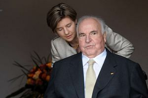 A 2010 photo shows former German Chancellor Helmut Kohl and his wife, Maike Richter-Kohl.