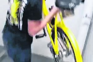 A screenshot of the video that went viral, showing someone throwing an ofo bicycle from an HDB block.
