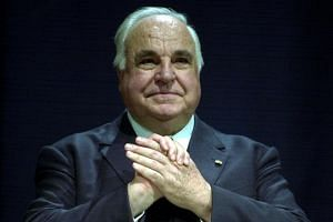Former German chancellor Helmut Kohl pausing during the celebration ofthe eleventh anniversary of German unification in Stuttgart, on Oct 3, 2001.