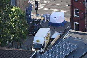 Police forensics officers prepare to examine the scene near Finsbury Park Mosque in which one man was killed after a vehicle ploughed into pedestrians in London, England, on June 19, 2017.